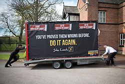 © Licensed to London News Pictures . 01/05/2015 . Manchester , UK . Activists wheel a party advertising trailer in to place for a Liberal Democrat party rally at Chorlton-cum-Hardy Golf Club . Liberal Democrat party leader Nick Clegg visits the constituency of Manchester Withington to deliver a speech on the NHS and campaign with local candidate John Leech . Photo credit : Joel Goodman/LNP