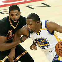 12 June 2017: Golden State Warriors forward Kevin Durant (35) drives past Cleveland Cavaliers center Tristan Thompson (13) during the Golden State Warriors 129-120 victory over the Cleveland Cavaliers, in game 5 of the 2017 NBA Finals, at the Oracle Arena, Oakland, California, USA.