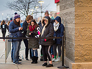 "28 NOVEMBER 2019 - ANKENY, IOWA: People line up at the Target store in Ankeny, Iowa, Thursday. ""Black Friday"" is the unofficial start of the Christmas holiday shopping season and has traditionally thought to be one of the busiest shopping days of the year. Brick and mortar retailers, like Target, are facing increased pressure from online retailers this year. Many retailers have started opening on Thanksgiving Day. Target stores across the country opened at 5PM on Thanksgiving to attract shoppers with early ""Black Friday"" specials.    PHOTO BY JACK KURTZ"
