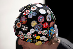 © Licensed to London News Pictures. 25/02/2012. LONDON, UK. Covered in badges bearing a multitude of causes and slogans, the hat of an Occupy London protester is seen at their camp site in London today (25/02/12). Occupy London protesters carried on with their demonstration today, even though they are waiting for eviction after losing a court battle for the right to keep their St Paul's Cathedral campsite. Photo credit: Matt Cetti-Roberts/LNP