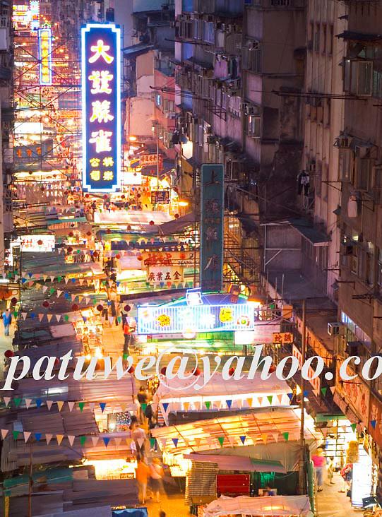 Open air night market at Temple street, at dusk, Yaumatei, Kowloon, Hong Kong, China