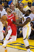 Golden State Warriors forward Draymond Green (23) defends Houston Rockets guard Eric Gordon (10) during Game 3 of the Western Conference Finals at Oracle Arena in Oakland, Calif., on May 20, 2018. (Stan Olszewski/Special to S.F. Examiner)