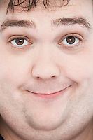 Overweight Man with Funny Expression portrait close up of face