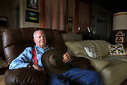 "Monty Richards, owner of Kahua Ranch is photographed in his living room in North Kohala, Hawaii.  ""Ranches are struggling,"" says Richardson, who sold a large piece of his ranch to real estate developers a number of years ago and also added ATV and horseback riding adventures to his ranch's offerings. High land taxes, rising costs of shipping cattle to the mainland and changing weather patterns have all adversely affected the viability of ranching in Hawaii."