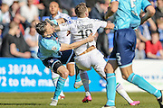 James Norwood (Tranmere Rovers) pushes the Grimsby defender out of the way to get to the header during the Vanarama National League match between Tranmere Rovers and Grimsby Town FC at Prenton Park, Birkenhead, England on 30 April 2016. Photo by Mark P Doherty.