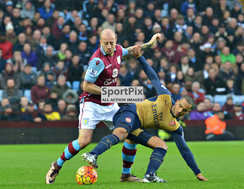 Auld Enemy as Aston Villa's Scottish defender Alan Hutton holds off his English opponent Theo Walcoitt.....(c) BILLY WHITE | SportPix.org.uk