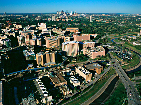 Aerial view of the Texas Medical Center with the downtown skyline beyond.