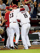 Sep. 27 2011; Phoenix, AZ, USA; Arizona Diamondbacks manager Kirk Gibson hugs pitcher Micah Owings (15) on the field after playing against the Los Angeles Dodgers at Chase Field. The Diamondbacks defeated the Dodgers 7-6 in extra innings.  Mandatory Credit: Jennifer Stewart-US PRESSWIRE.