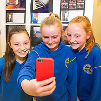 Hannah McCormack, Ellen McMahon and Ciara Meehan taking a selfie with their work on display in Glor