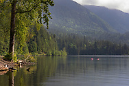Two kayakers at Jade Bay on Cultus Lake in Chilliwack, British Columbia, Canada.  Photographed from the Jade Bay Boat Launch at Cultus Lake Provincial Park.
