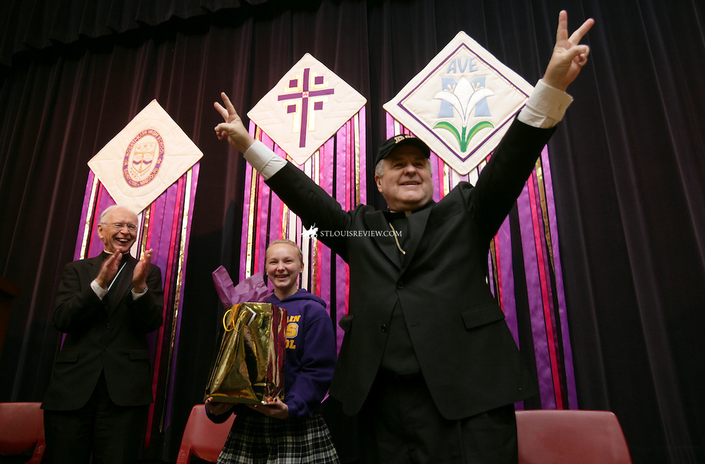 TUESDAY, APRIL 21, 2009 - Archbishop-elect Robert J. Carlson was greated by exuberant students at Rosati-Kain High School on first visit to his new archdiocese Tuesday...Photo by Jerry Naunheim Jr.... ..