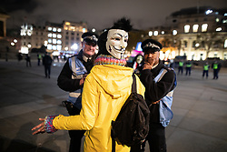 © Licensed to London News Pictures . 05/11/2019. London, UK. Supporters of Anonymous , many wearing Guy Fawkes masks , attend the Million Mask March bonfire night demonstration , in Trafalgar Square in central London . Photo credit: Joel Goodman/LNP
