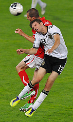 03.06.2011, Ernst Happel Stadion, Wien, AUT, UEFA EURO 2012, Qualifikation, Oesterreich (AUT) vs Deutschland (GER), im Bild Kopfballduell zwischen Stefan Kulovits, (AUT, #7) und Thomas Mueller, (GER, #13) // during the UEFA Euro 2012 Qualifier Game, Austria vs Germany, at Ernst Happel Stadium, Vienna, 2010-06-03, EXPA Pictures © 2011, PhotoCredit: EXPA/ M. Gruber