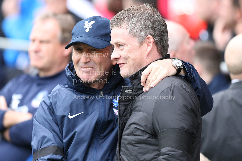 Crystal Palace manager Tony Pulis greets Cardiff City manager Ole Gunnar Solskjaer ahead of the match. Barclays Premier league match, Cardiff city v Crystal Palace at the Cardiff city stadium in Cardiff, South Wales on Saturday 5th April 2014.<br /> pic by Mark Hawkins, Andrew Orchard sports photography.