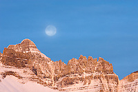 Moon over Mount Wilbur 9,321 ft (2,841 m) at dawn, Glacier National park Montana USA