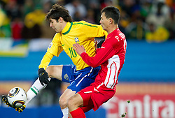 Kaka of Brazil vs Pak Chol Jin of North Korea during the 2010 FIFA World Cup South Africa Group G match between Brazil and North Korea at Ellis Park Stadium on June 15, 2010 in Johannesburg, South Africa. Brazil defeated Korea 2-1. (Photo by Vid Ponikvar / Sportida)