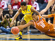 The University of Michigan men's basketball team defeats Texas, 79-65, during the third round of the NCAA Championship at the BMO Harris Bradley Center in Milwaukee on March 22, 2014.
