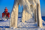 Ice formations on the pier to the Canal Station Pier-head Light in Sturgeon Bay, Wisconsin in Door County. Photo by Mike Roemer / Mike Roemer Photography Inc.  RoemerPhoto.com.  920-217-8021.