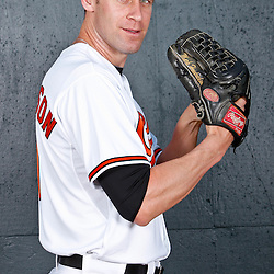 February 26, 2011; Sarasota, FL, USA; Baltimore Orioles pitcher Mark Hendrickson (31) poses during photo day at Ed Smith Stadium.  Mandatory Credit: Derick E. Hingle
