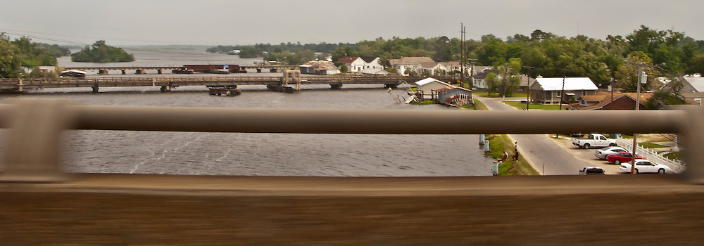 Bayou Des Allemands viewed from US-90 highway bridge with two other bridges in view and the town of Des Allemands, Louisiana USA