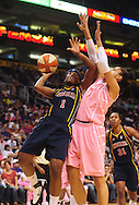 Aug 8, 2010; Phoenix, AZ, USA; Indiana Fever guard Shavonte Zellous puts up a basket against Phoenix Mercury forward Candice Dupree during the first half at US Airways Center.  Mandatory Credit: Jennifer Stewart-US PRESSWIRE