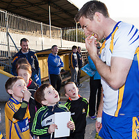 Clare's Gary Brennan teaching the young supporters the importance of wearing a gum shield while playing football