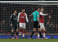 Football - 2017 / 2018 Premier League - Arsenal vs. Manchester City<br /> <br /> Referee Andre Marriner points to the penalty spot to give Arsenal hope of reducing the deficit at The Emirates.<br /> <br /> COLORSPORT/DANIEL BEARHAM