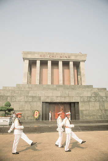 Vietnames honor guard march in front of Ho Chi Minh Mausoleum in Hanoi Vietnam