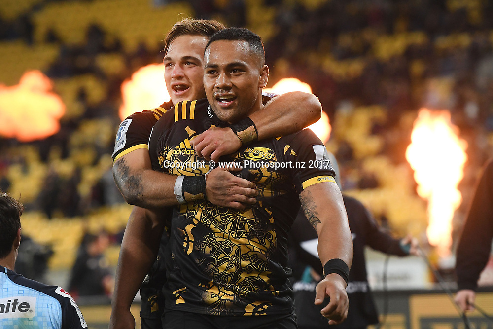 Hurricanes' Ngani Laumape (R celebrates his try with team mate Wes Goosen during the Hurricanes vs Waratahs Super Rugby match at Westpac Stadium in Wellington on Friday the 7th of April 2017. Copyright Photo by Marty Melville / www.Photosport.nz