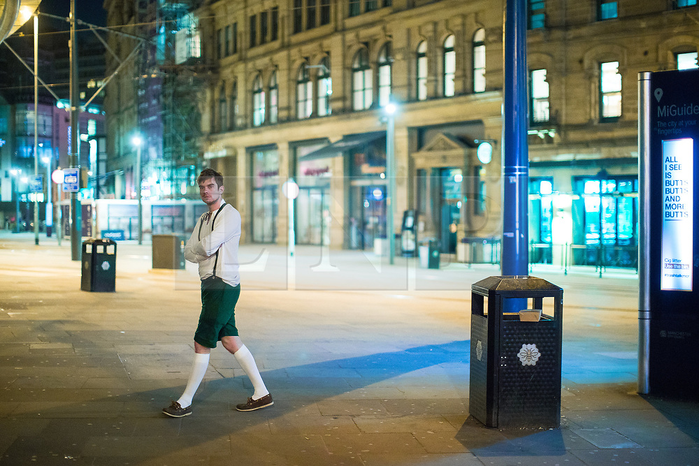 © Licensed to London News Pictures . 08/04/2017 . Manchester , UK . A man crosses Exchange Square as a Disney themed pub crawl passes through The Printworks in Manchester City Centre . Greater Manchester Police have authorised dispersal powers and say they will ban people from the city centre for 48 hours , this evening (7th April 2017) , in order to tackle alcohol and spice abuse . Photo credit : Joel Goodman/LNP