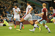 Milton Keynes Dons midfielder Jordan Spence gets down the wing during the Sky Bet Championship match between Burnley and Milton Keynes Dons at Turf Moor, Burnley, England on 15 September 2015. Photo by Simon Davies.