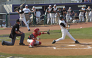 Kansas State's Joe Roundy hits a three run homer in the bottom of the eighth inning to give the Wildcats a 7-5 lead over Texas Tech.  Kansas State defeated Texas Tech 7-5 at Tointon Stadium in Manhattan, Kansas on April 16, 2005.