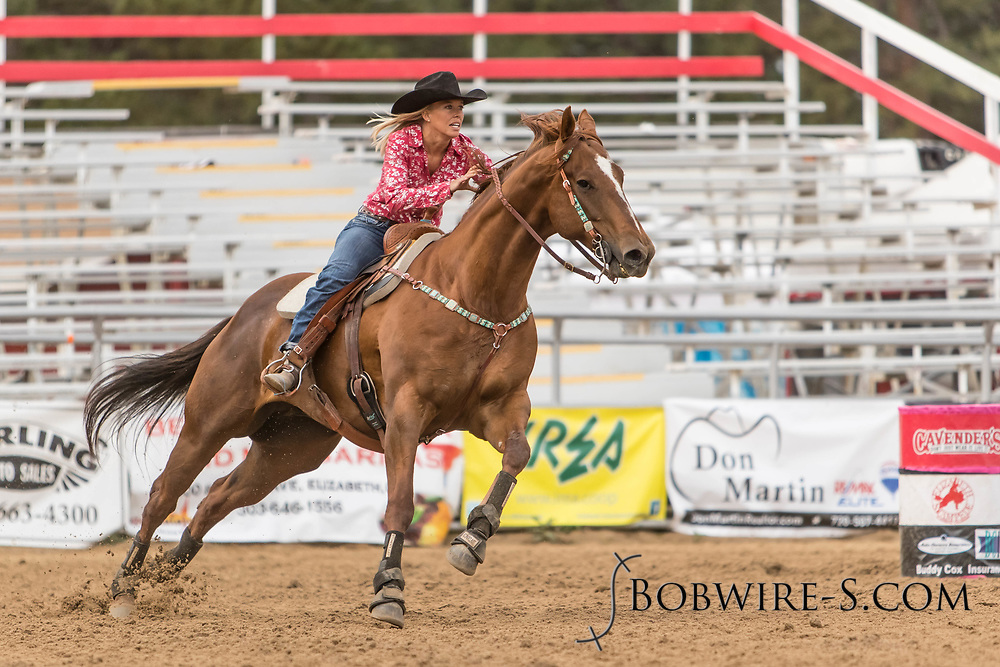 Alyssa Loflin makes her barrel racing run during slack at the Elizabeth Stampede on Sunday, June 3, 2018.
