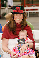 3 months old yesterday Éalga Monaghan Sinead Deely from Athenry at the Friday evening Meeting of the Galway Races. Photo:Andrew Downes.