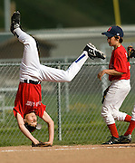 NEWS&GUIDE PHOTO / PRICE CHAMBERS.His teammates watch as Ryder Marshall does cartwheels down the third baseline during a game at the Alpine Field near Jackson Hole Middle School on June 4.