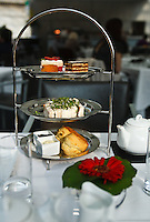 Treats on a tiered tray at afternoon tea at the British Museum, London, England.