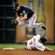 Brewers' Craig Counsell tags out Astros' Darin Erstad at second base as he attempts the double play on a ball hit by Kazuo Matsui in the seventh inning. Thursday, June 12, 2008, in Houston. ( Leonardo Carrizo / Chronicle )