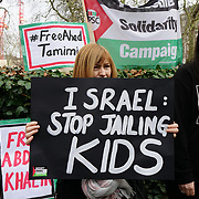Human rights activists holding a banner protest outside US embassy on 13th January 2018 of Israel Palestinian Child prisoners and demand Ahed Tamimi to be free immediately plus over 300 Palestinian Child Prisoners. Protestors shout slogan US/UK to stop arming Israel.