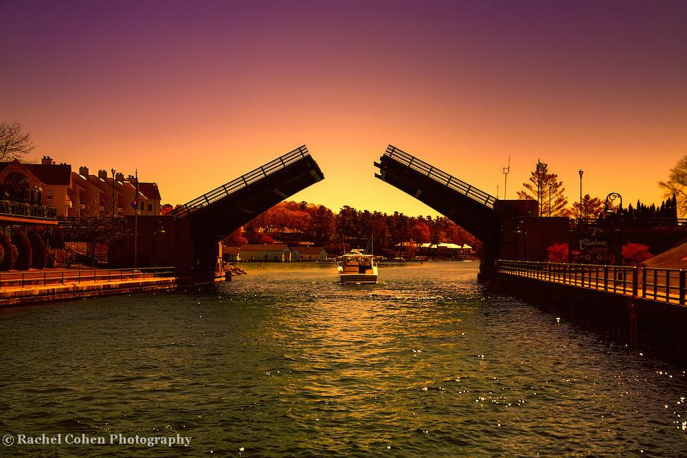 &quot;Cruisin in Color&quot;<br /> <br /> Beautiful sunset cruise through the drawbridge in Charlevoix Michigan!