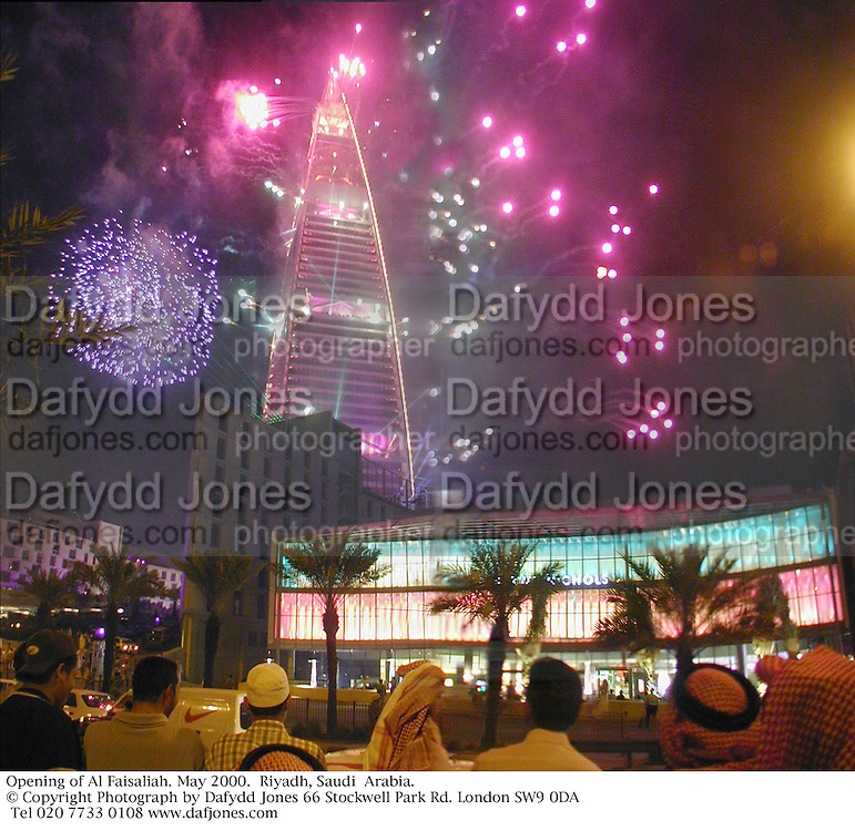 Celebrations and fireworks during the Opening of Harvey Nichols & Al Faisaliah mall. May 2000.  Riyadh, Saudi  Arabia. © Copyright Photograph by Dafydd Jones 66 Stockwell Park Rd. London SW9 0DA Tel 020 7733 0108 www.dafjones.com