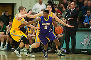 Great Danes guard Evan Singletary (0) looks to pass the ball while being guarded by Catamounts guard Cam Ward (14) and Catamounts forward Drew Urquhart (25) during the men's basketball game between the Albany Great Danes and the Vermont Catamounts at Patrick Gym on Wednesday night January 28, 2015 in Burlington, Vermont. (BRIAN JENKINS, for the Free Press)