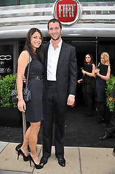 WILL & LOHRALEE ASTOR at a party to launch the Gucci designed Fiat 500 customized by Gucci Creative Director Frida Giannini in collaboration with FIAT's Centro Stile, held at Fiat, 105 Wigmore Street, London on 27th June 2011.