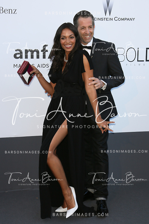 CAP D'ANTIBES, FRANCE - MAY 23:  Rosario Dawson and Kenneth Cole arrive at amfAR's 20th Annual Cinema Against AIDS at Hotel du Cap-Eden-Roc on May 23, 2013 in Cap d'Antibes, France.  (Photo by Tony Barson/FilmMagic,)