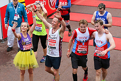 © Licensed to London News Pictures. 28/04/2019. London, UK. Mass runners at the finish line of 2019 Virgin Money London Marathon. Photo credit: Dinendra Haria/LNP