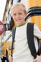 School Boy by School Bus