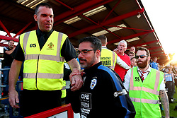 Huddersfield Town manager David Wagner is led away by stewards after an angry Blackburn Rovers fan confronts and questions his team selection at the end of the previous season - Mandatory by-line: Robbie Stephenson/JMP - 12/07/2017 - FOOTBALL - Wham Stadium - Accrington, England - Accrington Stanley v Huddersfield Town - Pre-season friendly