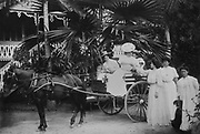Group of Western women wearing white dresses with a horse and carriage, in front of the Goupil residence, photograph, early 20th century, by F Homes, in the MTI-TFM Collection (fonds de la Polynesie Francaise), in the Musee de Tahiti et des Iles, or Te Fare Manaha, at Punaauia, on the island of Tahiti, in the Windward Islands, Society Islands, French Polynesia. The Museum of Tahiti and the Islands was opened in 1974 and displays collections of nature and anthropology, habitations and artefacts, social and religious life and the history of French Polynesia. Picture by Manuel Cohen
