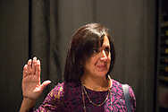 Hempstead, New York, USA. January 1, 2018. Off-stage, Hempstead Town Clerk SYLVIA CABANA (with Assemblywoman Michaelle Solanges who will administer oath), rehearse Swearing-In before ceremony at Hofstra University.