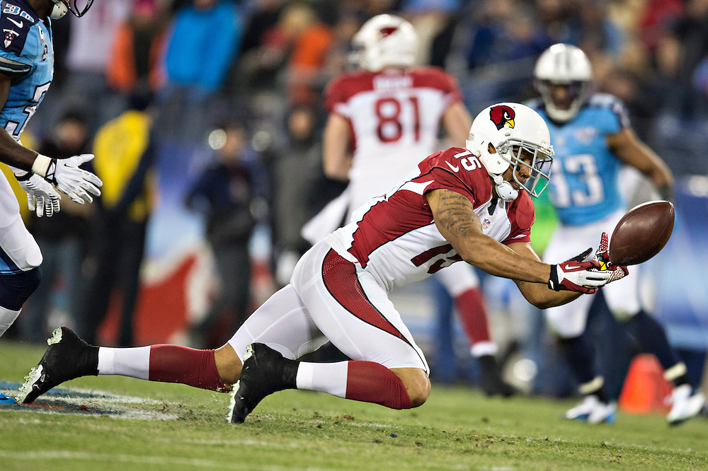 NASHVILLE, TN - DECEMBER 15:  Michael Floyd #15 of the Arizona Cardinals misses a pass against the Tennessee Titans at LP Field on December 15, 2013 in Nashville, Tennessee.  The Cardinals defeated the Titans 37-34.  (Photo by Wesley Hitt/Getty Images) *** Local Caption *** Michael Floyd