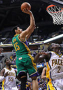Feb. 21, 2012; Indianapolis, IN, USA; New Orleans Hornets power forward Gustavo Ayon (15) shoots the ball against the Indiana Pacers at Bankers Life Fieldhouse. Indiana defeated New Orleans 117-108. Mandatory credit: Michael Hickey-US PRESSWIRE